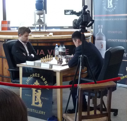 Carlsen and Ding playing